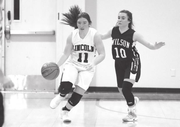 Lincoln boys lose to Wilson; girls bring it home