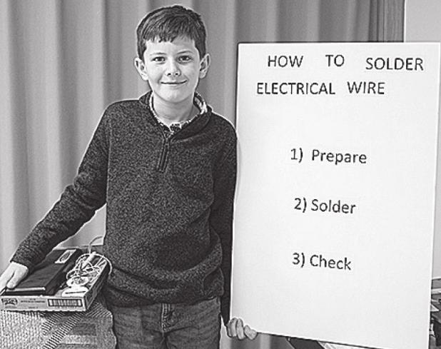 Sorensen demonstrates soldering at 4-H Day