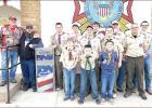 Boy Scout Troop 90 places new U.S.A. fl ag drop box outside VFW Post #7928